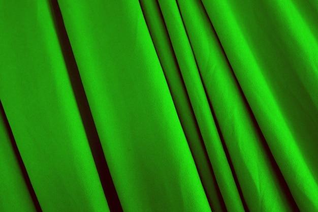 La bella seta verde liscia liscia o la trama satinata possono essere utilizzate come sfondo. tessuto