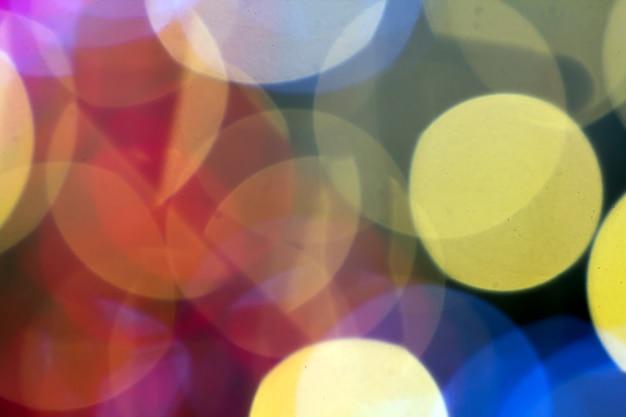 Bellissimo sfondo morbido bokeh multicolor. pattern di luci sfocati.