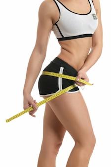 Bellissimo corpo sportivo da donna con tipo di misura giallo