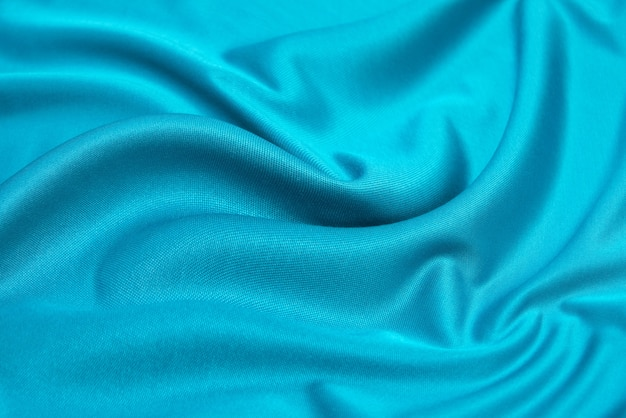 Bellissimo tessuto jersey turchese drappeggiato con piccole pieghe