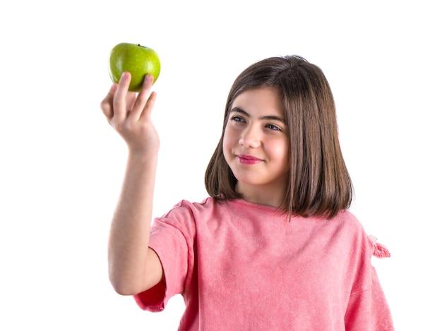 Bellissima studentessa con la mela su bianco