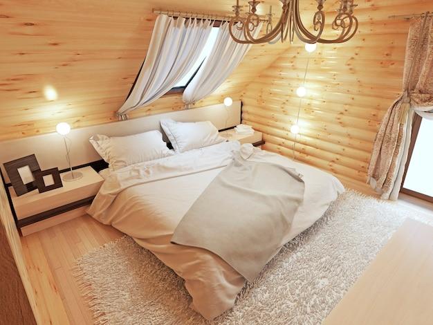 Interno camera da letto in un tronco al piano attico con una finestra sul tetto