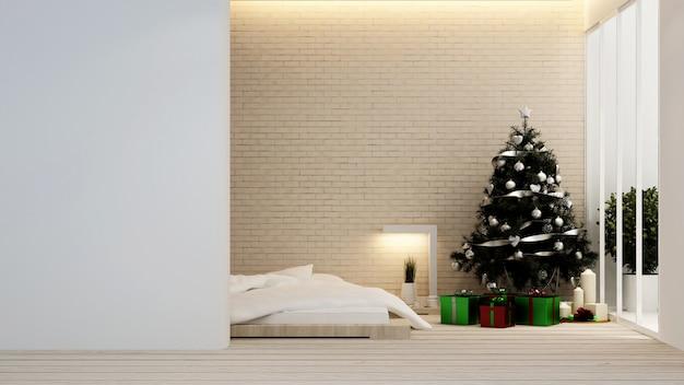 Camera da letto con albero di natale in hotel o appartamento - interior design - rendering 3d