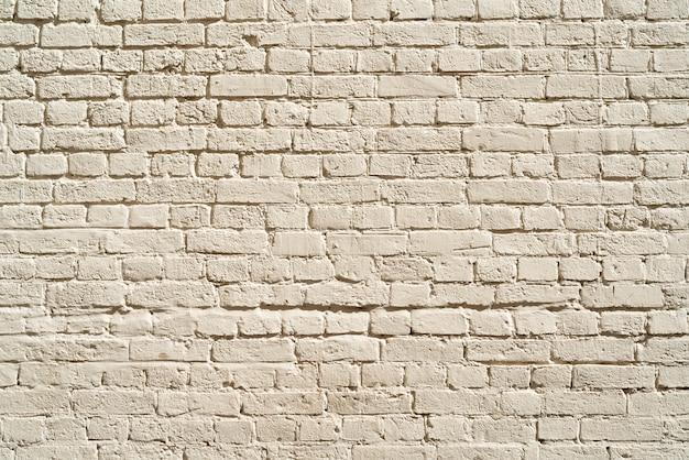 Muro di mattoni beige. loft interior design. vernice beige della facciata.