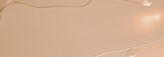 Beige texture cosmetica sfondo trucco e prodotti cosmetici per la cura della pelle crema rossetto fondotinta ma...
