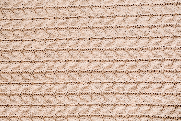 Motivo a trama di lana lavorata a maglia beige