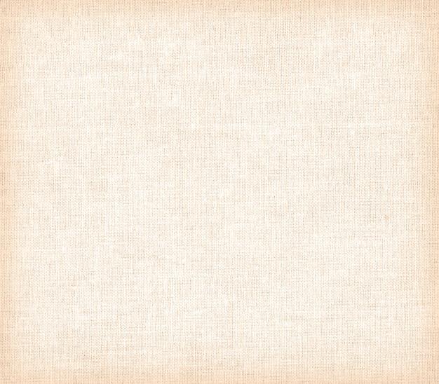 Fondo o struttura della tela di carta beige - primo piano.