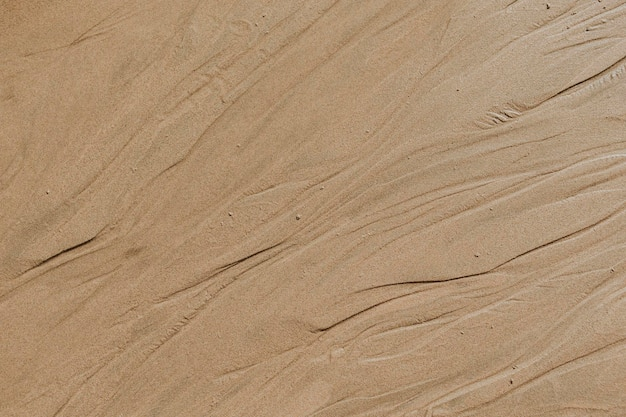 Fondo strutturato della spiaggia sabbiosa beige
