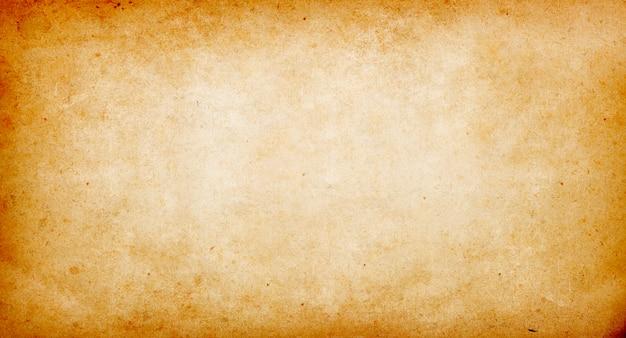 Sfondo vintage beige di vecchia carta, struttura della carta, macchie, rugosità, striature