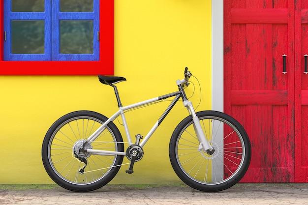 Bicicletta parcheggiata di fronte all'edificio della casa europea vintage retrò con porta rossa, finestra blu e parete gialla, primo piano estremo di scena di strada stretta. rendering 3d