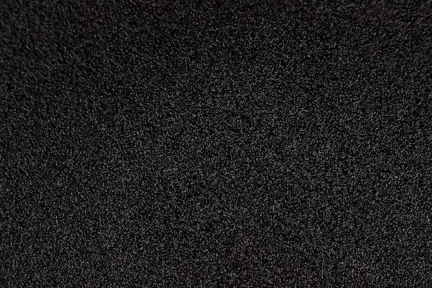 Fondo o struttura astratto nero, fondo ruvido nero. texture di carta abrasiva impermeabile. trama di carta vetrata nera.