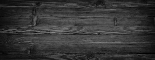 Sfondo nero invecchiato texture di legno sfondo senza giunture, tavolo in legno scuro