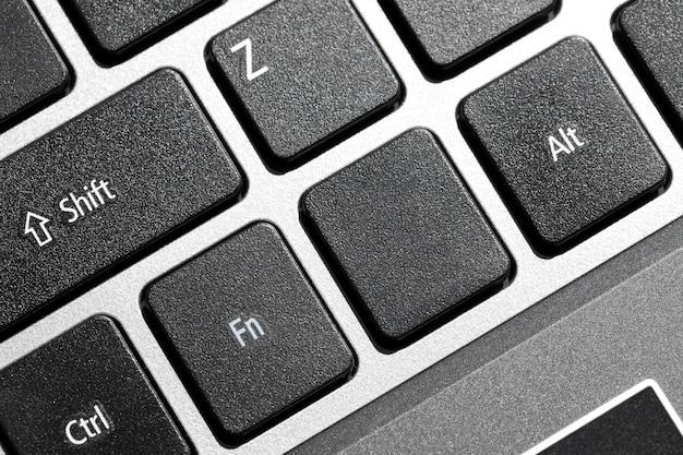 Tasto della tastiera del computer in bianco nero con copyspace