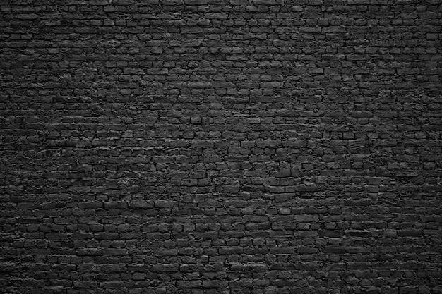 Muro di mattoni nero, blocchi di pietra di vecchia struttura
