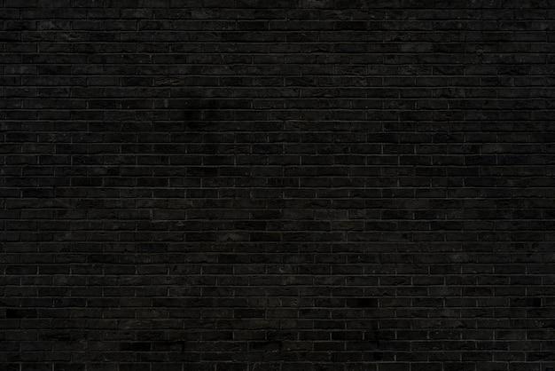 Struttura del muro di mattoni neri. costruzione di sfondo architettonico.