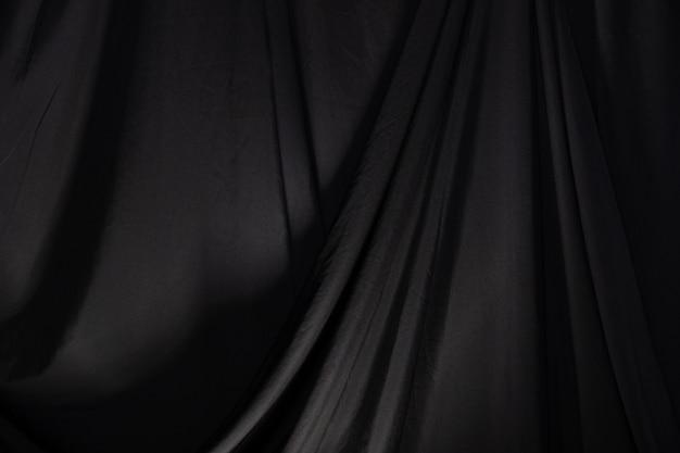 Onda drappo tenda nera con illuminazione da studio