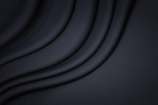 Sfondo texture tessuto nero. tessuto e materiale in cotone di lusso in bianco.