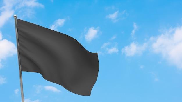 Bandiera nera in pole. cielo blu.