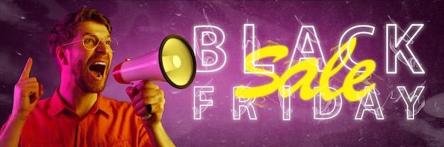 Concetto di acquisti di vendita del venerdì nero lettere illuminate al neon su sfondo sfumato