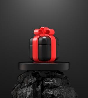 Confezione regalo nera su display roccia nera