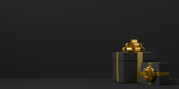 Scatole regalo nere con fiocchi dorati