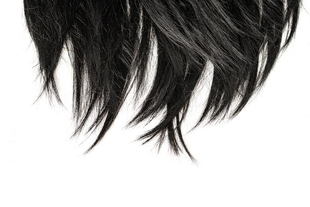 Punte dei capelli neri isolate su bianco.