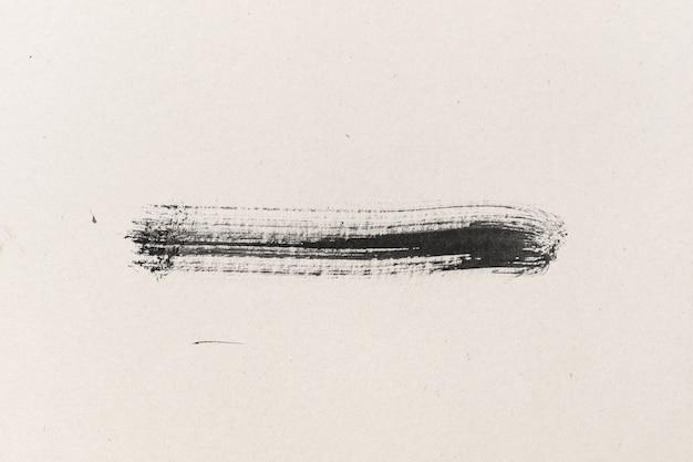 Forma di inchiostro nero su sfondo strutturato di carta per acquerello