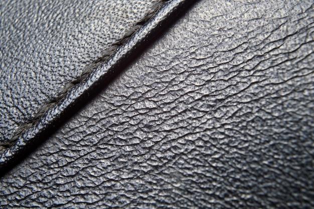 Texture in pelle nera con una cucitura
