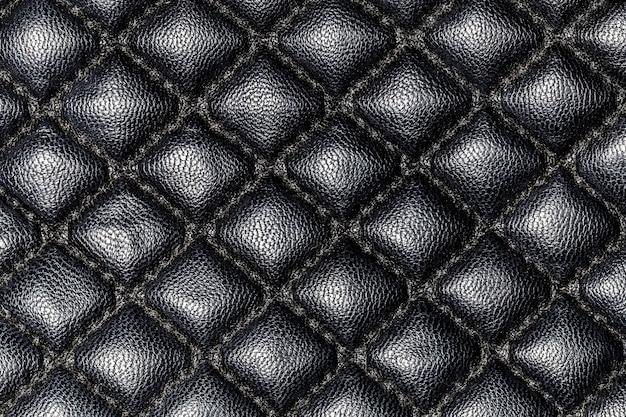 Pelle nera con priorità bassa di struttura del primo piano dei rombi
