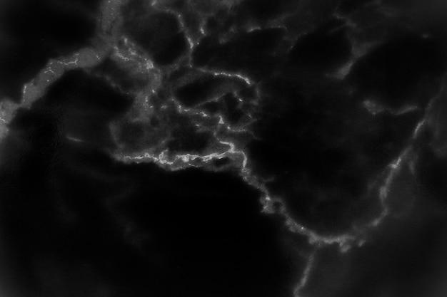 Trama di marmo nero con motivo naturale per opere d'arte di sfondo o di design.