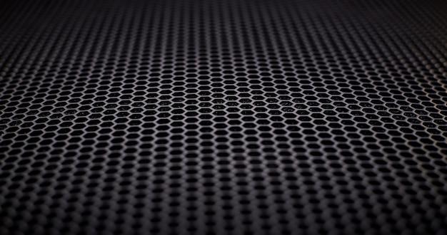 Una griglia in metallo nero come sfondo.