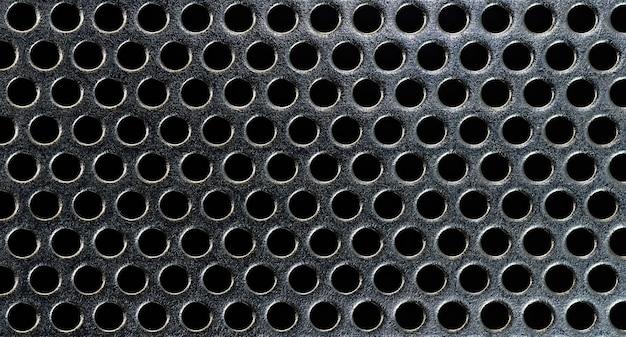 Struttura in metallo nero con fori rotondi