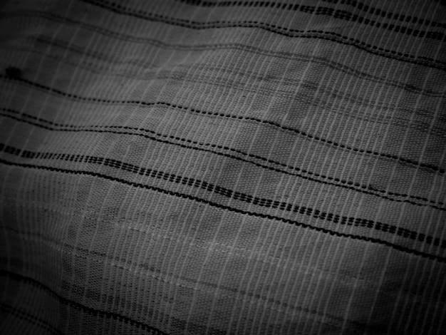 Superficie del fondo dello spazio dell'estratto del tessuto di lino naturale nero