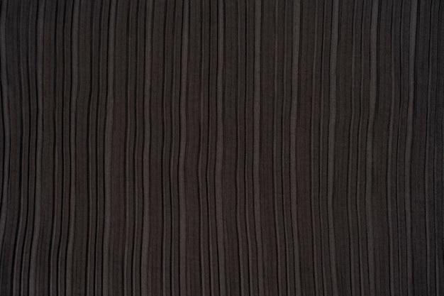 Tessuto plissettato nero trama di sfondo tessuto plissettato la trama del tessuto plissettato nero