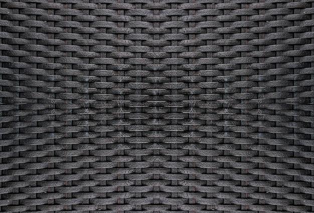 Fondo nero di struttura del tessuto del rattan