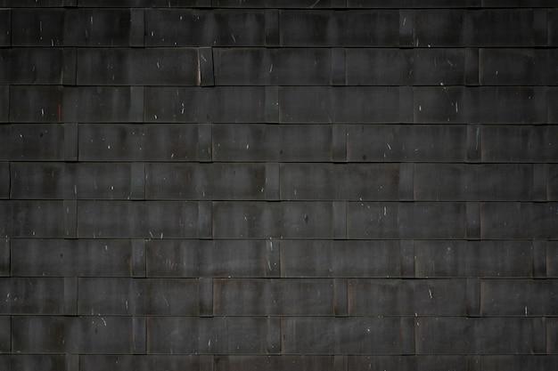 Il motivo del tetto in gomma quadrata grezza nera per lo sfondo in qualche luogo della thailandia.