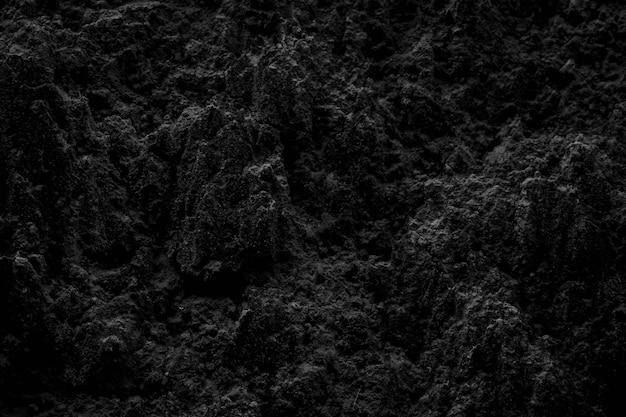 Bellissimo sfondo naturale del suolo nero per il design