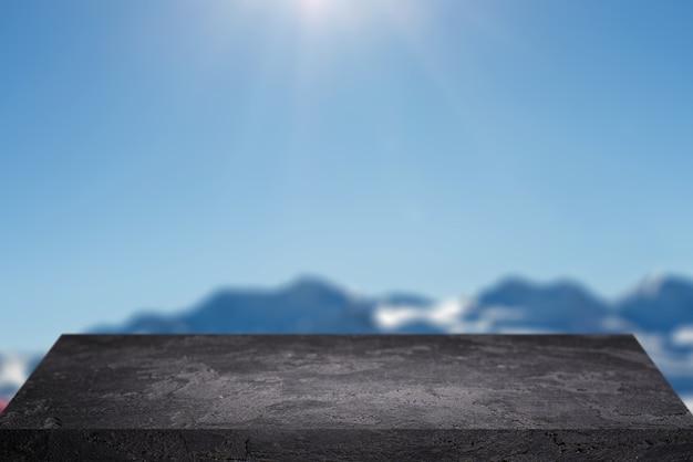 Superficie di pietra nera contro il cielo blu con colline durante il giorno