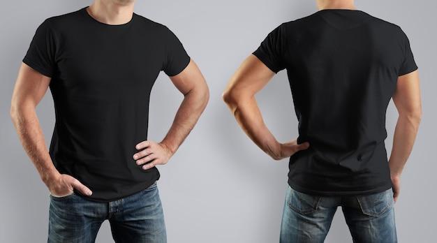 Maglietta nera su uomo forte sul muro grigio. vista frontale e posteriore.