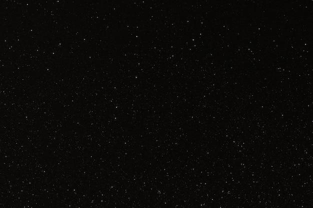 Texture nera con micro rilievi e glitter simile al cielo notturno con stelle