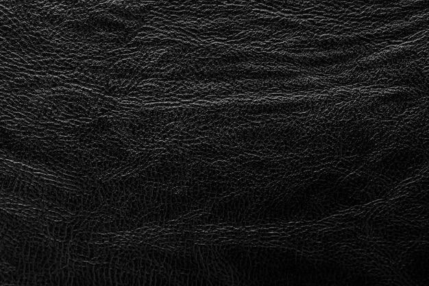 Sfondo nero in pelle martellata. texture in pelle astratta.