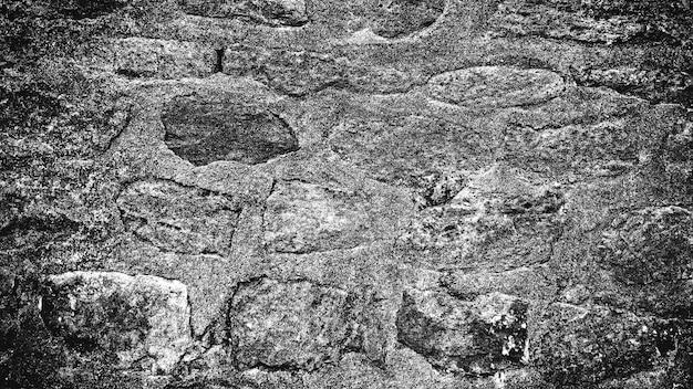 Sfondo bianco e nero del vecchio muro di pietra