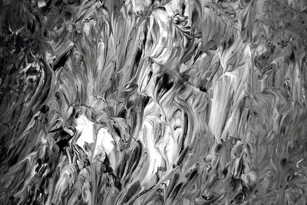 Pennellate in bianco e nero con texture di sfondo