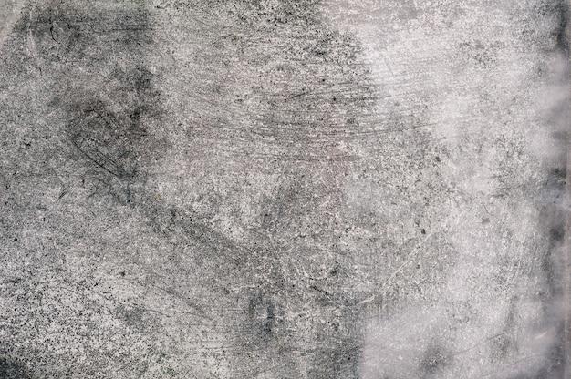 Muro di cemento bianco e nero con sfondo rilievo in gesso