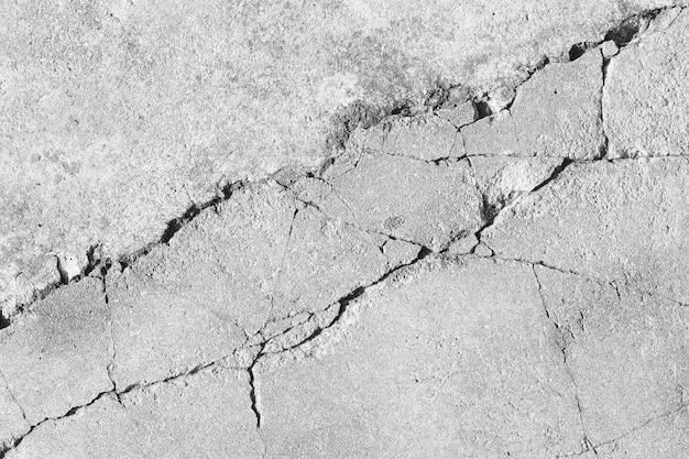 Fondo di struttura del pavimento incrinato in bianco e nero
