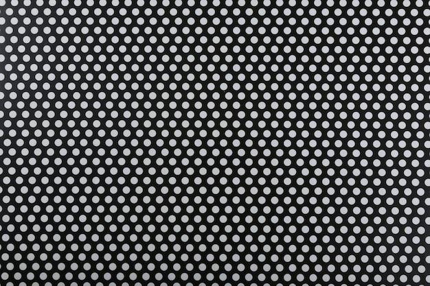 Trama motivo decorativo bianco e nero con palline ripetute..
