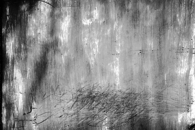 In bianco e nero del fondo arrugginito della parete dello zinco di lerciume.