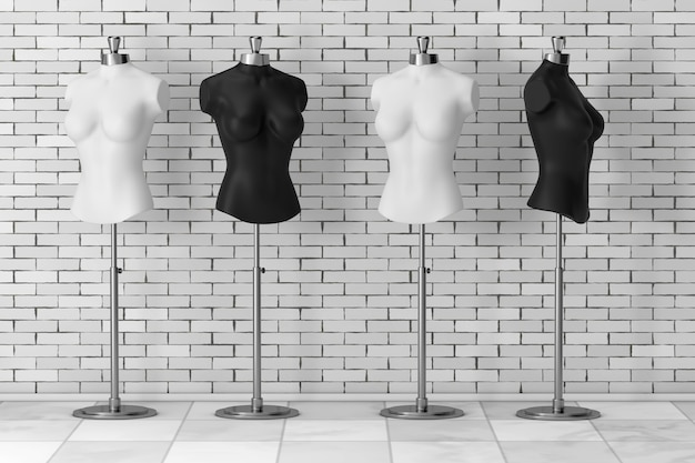 Mennequins delle donne del sarto dell'annata in bianco e nero davanti al muro di mattoni. rendering 3d