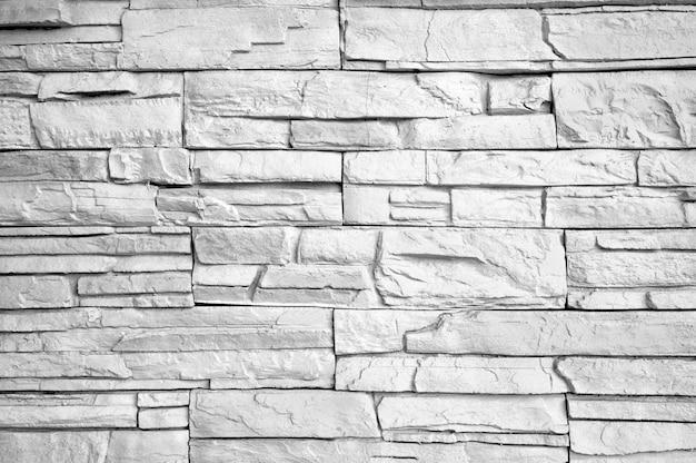 Fondo bianco e nero di struttura di arte moderna astratta del mattone della parete