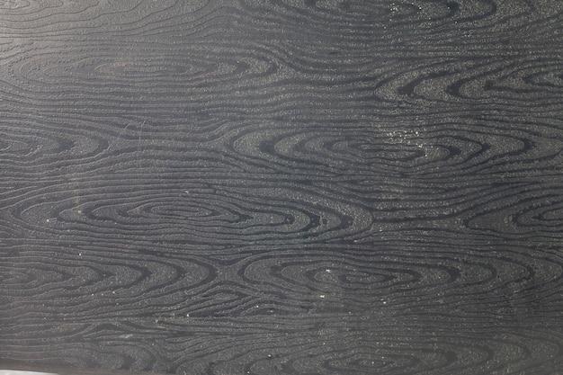 Sfondo di legno nero.